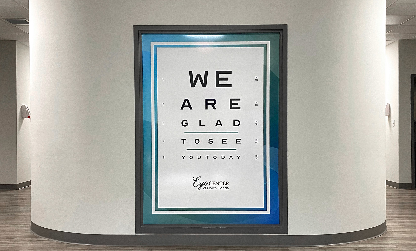 "Image of a sign reading ""We are glad to see you today"" in the Eye Center building."