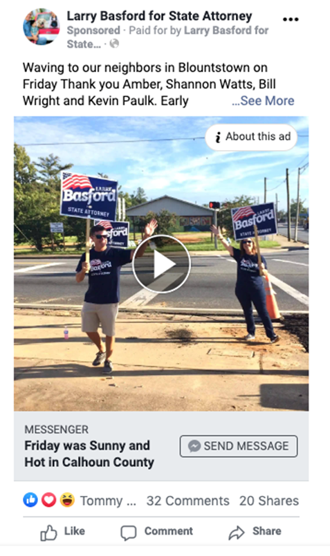 A person holding a sign  Description automatically generated