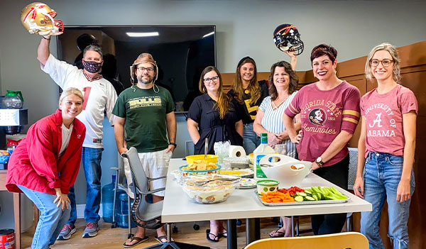Image of the KMA team kicking off Fall 2020 with good food and their team colors!